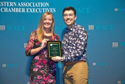 Kelly McCandles of the Billings Chamber accepting the 2018 W.A.C.E. website award